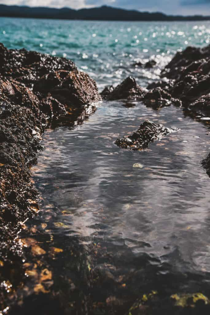 water flowing into a rocky inlet